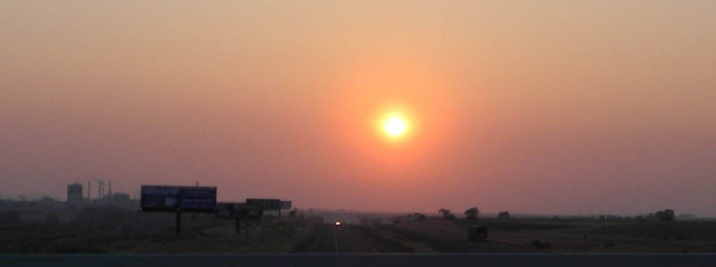 Sun setting through the smoked out sky, looking west from Chubbuck, Idaho, 12 September 2012.